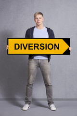 Man showing diversion sign.
