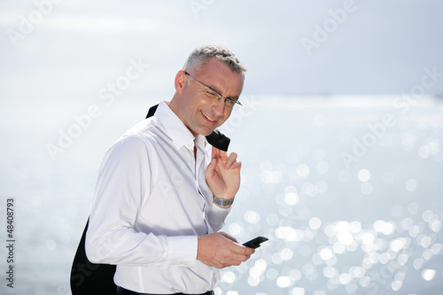 businessman on vacation talking on his cell