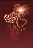 Firework in a shape of heart on the red background.