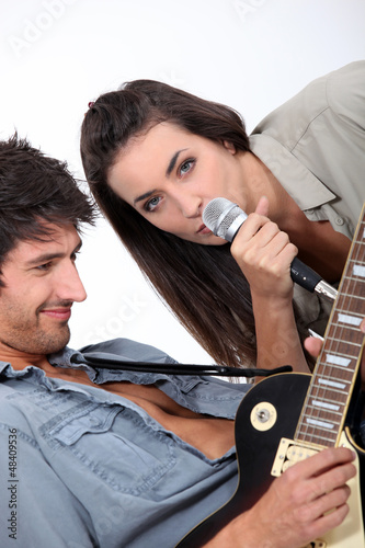 a female singer and a guitarist
