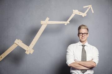 Confident businessman with graph.