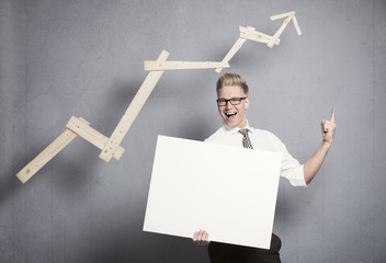Confident businessman with white empty panel pointing up.