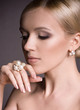 young woman with makeup in luxury jewelry