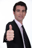 Businessman giving the thumb's up
