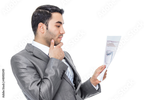 Businessman reading - looking papers, isolated