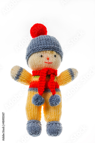Colorful handmade knitted toy on white background
