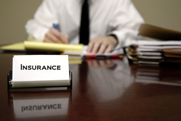 Insurance Man Sitting at Desk