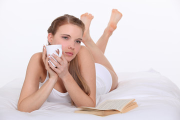 Woman drinking coffee in bed