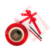 Red coffee cup and love letter with bow