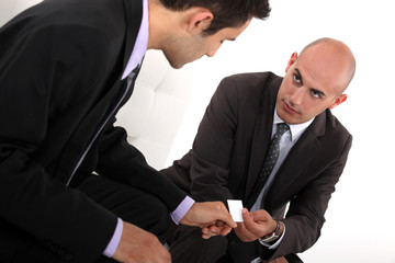 Businessmen exchanging cards