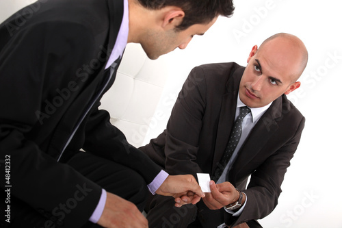 Businessmen exchanging cards
