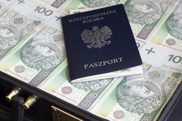 Suitcase passport and polish money corruption and escape concept