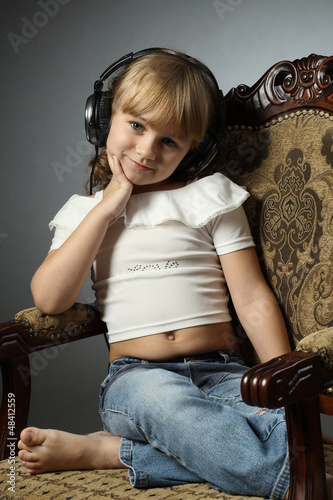 Beautiful girl listening to music on headphone