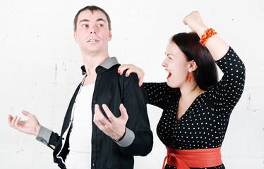Jealous woman striking at her man