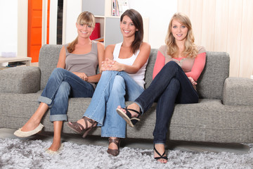 Women sitting on a sofa