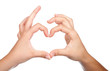 Two teenager hands form a heart shape with their fingers. on whi