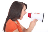 Woman screaming into a megaphone