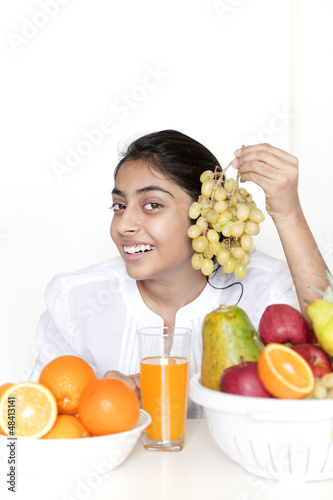 Pretty girl with fruits