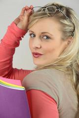 Seductive blond holding folders