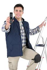 tiler holding a cell phone