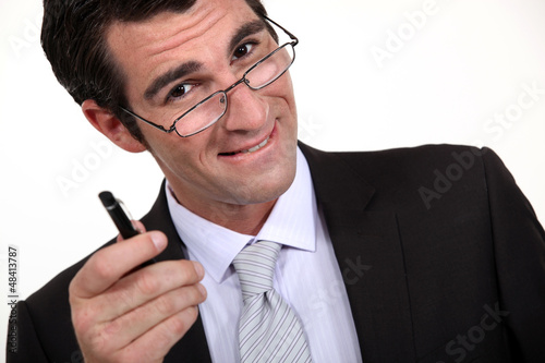 Businessman pointing his pen at you