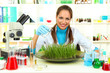 Young female scientist is conducting experiments with plants in