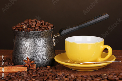 Coffee maker with yellow cup on wooden table