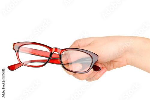 woman hand holding beautiful glasses isolated on white