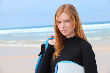 Redhead girl with surfboard