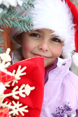 Little girl in a Santa hat