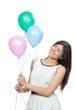 girl with colorfull balloons as a present for birthday party