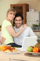 Affectionate young couple in the kitchen