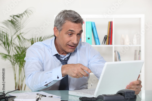 expressive worker in front of computer