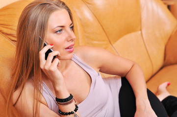 Portrait of a beautiful young woman talking on mobile phone