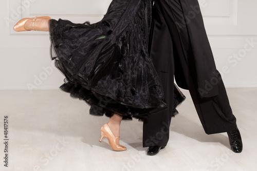 partners in the dance of feet on the floor Plakát