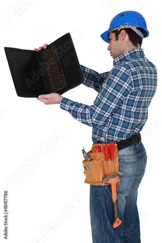 craftsman examining his laptop