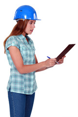 Shocked woman holding clipboard