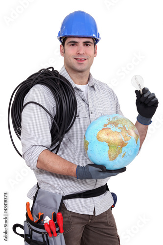 craftsman holding a bulb and a globe