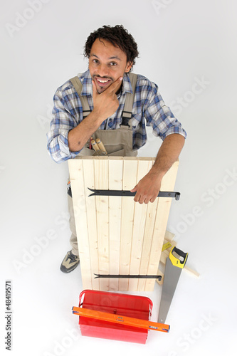 carpenter working on a wooden piece