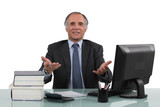 mature businessman sitting at his desk