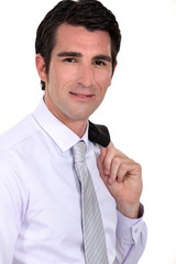 Businessman with his jacket over his shoulder