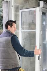 Worker installing French doors