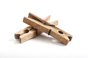 old wooden clothes pegs  on white background