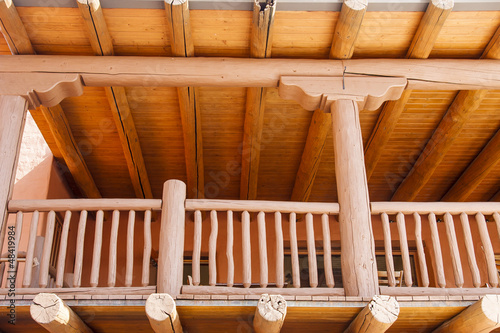 Wood Porch on Adobe Building