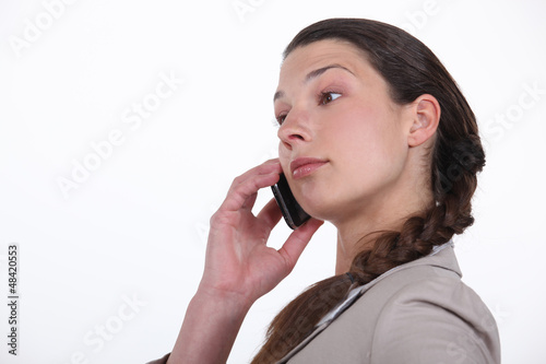 Profile shot of brunette on the phone