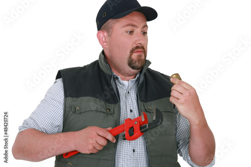 Apprehensive handyman staring at an object