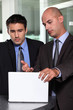 Businessman showing his associate a report