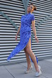 Fashion model wearing blue couture designer dress