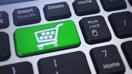 Online Shopping. Tracking shot of the key Shopping Cart.