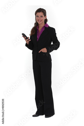 Brunette holding mobile telephone